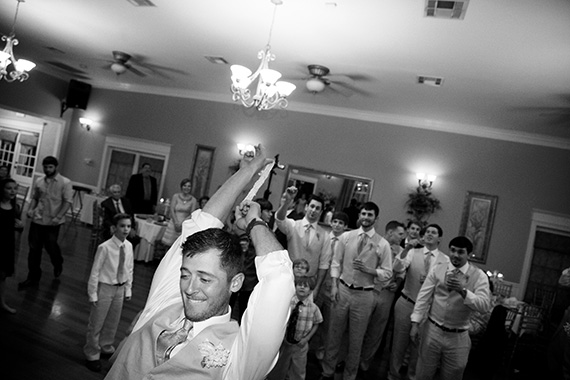 Tate Tullier Photography - Gatehouse wedding - groom-launches-the-garter