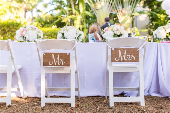 Filda Konec Photography - Hemingway House Wedding - mr. and mrs. chair signs for bride and groom's wedding