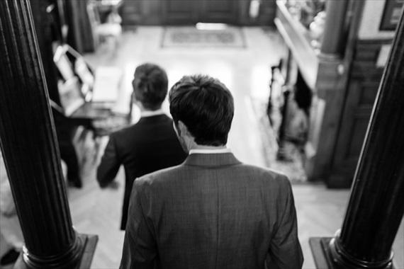 Filda Konec Photography - Hemingway House Wedding - groom walks down steps with best man