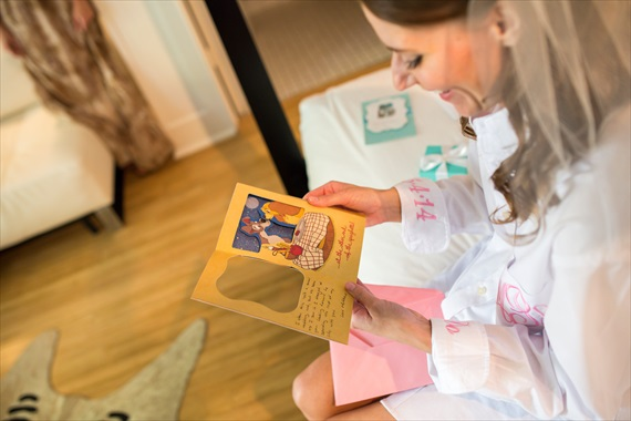 Filda Konec Photography - Hemingway House Wedding - bride reads card for her wedding gift