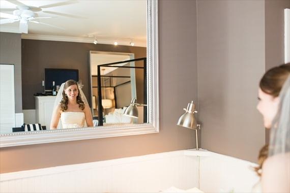 Filda Konec Photography - Hemingway House Wedding - bride looks in mirror