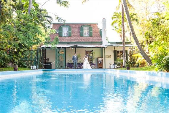Filda Konec Photography - Hemingway House Wedding - bride and groom overlooking pool in key west