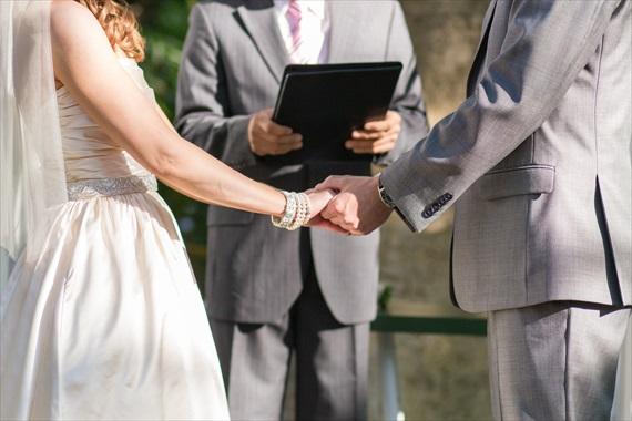 Filda Konec Photography - bride and groom hold hands