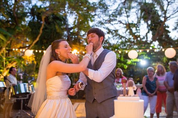 Filda Konec Photography - bride and groom with wedding cake fun