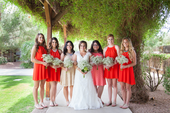 rustic chic arizona wedding at Shenandoah Mill with bride and bridesmaids in red dresses