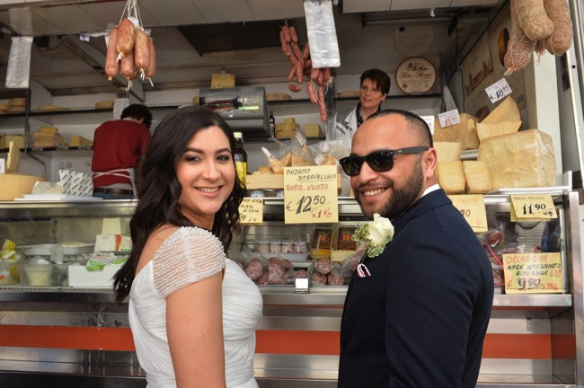 bride and groom outside Italian Deli| Planner: Venice Events | via https://emmalinebride.com/real-weddings/spring-wedding-in-italy-andre-shona/