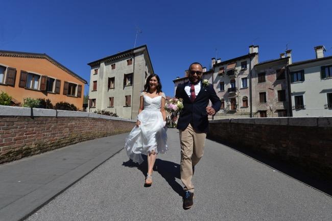 bride and groom run over bridge | Planner: Venice Events | via http://emmalinebride.com/real-weddings/spring-wedding-in-italy-andre-shona/