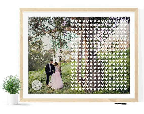 Wedding Guest Book Alternative Print with Hearts Atop Engagement Photo | 21 Unique Themed Guest Book Alternatives via https://emmalinebride.com/reception/themed-guest-book-alternatives/