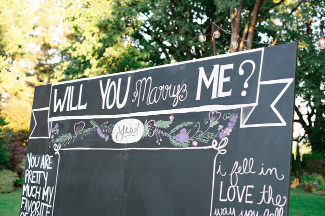 will you marry me chalk board sign| Photo: White Ivory Photography | via https://emmalinebride.com/real-weddings/hipster-engagement-session-what-does-one-look-like/