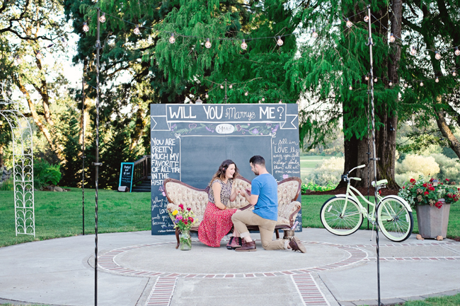 couple proposal by chalkboard sign in styled shoot| Photo: White Ivory Photography | via https://emmalinebride.com/real-weddings/hipster-engagement-session-what-does-one-look-like/