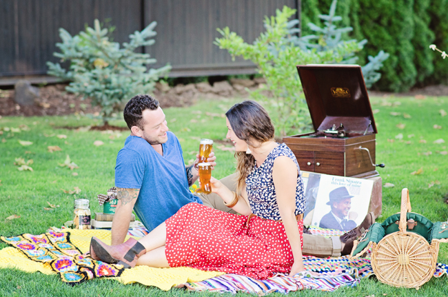 hipster engagement session on picnic blanket| Photo: White Ivory Photography | via https://emmalinebride.com/real-weddings/hipster-engagement-session-what-does-one-look-like/