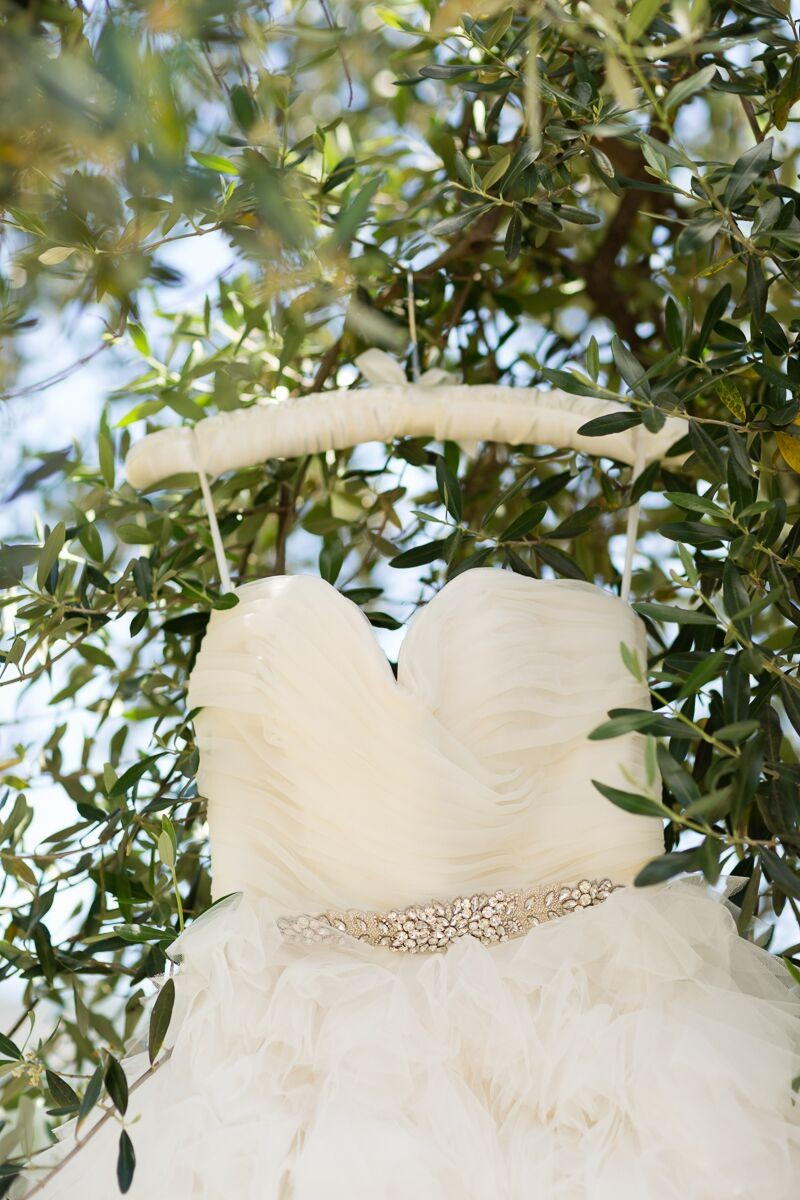 Winery Style Wedding Shoot - Wedding Gown on Satin Hanger (photo: olivia smartt) https://emmalinebride.com/themes/winery-style-wedding/