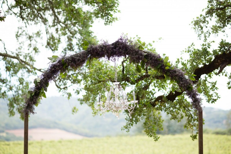 Winery Style Wedding Shoot - ceremony arch with chandelier (photo: olivia smartt) http://emmalinebride.com/themes/winery-style-wedding/
