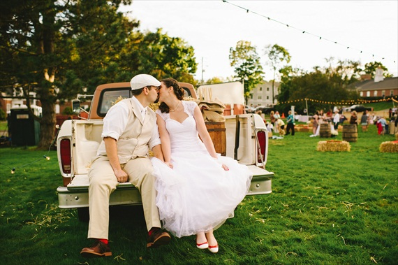 Americana Wedding - bride and groom kissing on pickup truck (photo: michelle gardella)