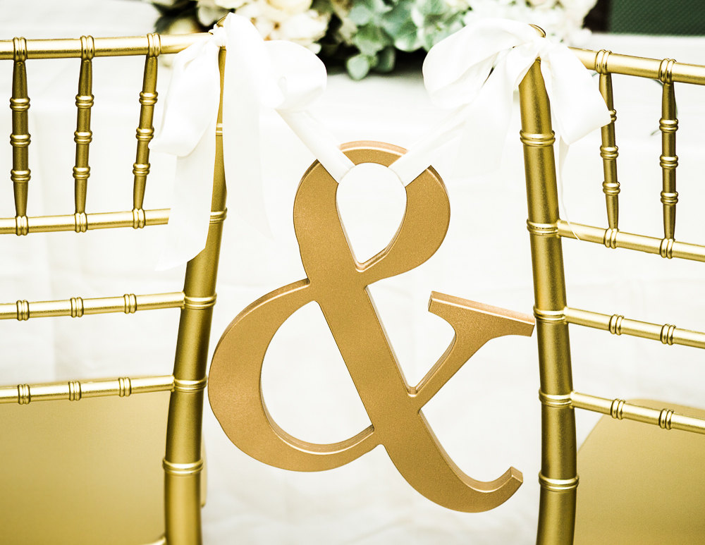 ampersand gold chair sign | via bride and groom chair signs https://emmalinebride.com/decor/bride-and-groom-chairs/