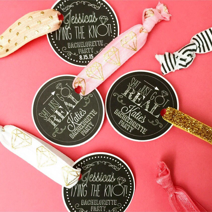 bachelorette party hair tie favors by flhair accessories | fun bachelorette party ideas | http://emmalinebride.com/planning/fun-bachelorette-party-ideas/