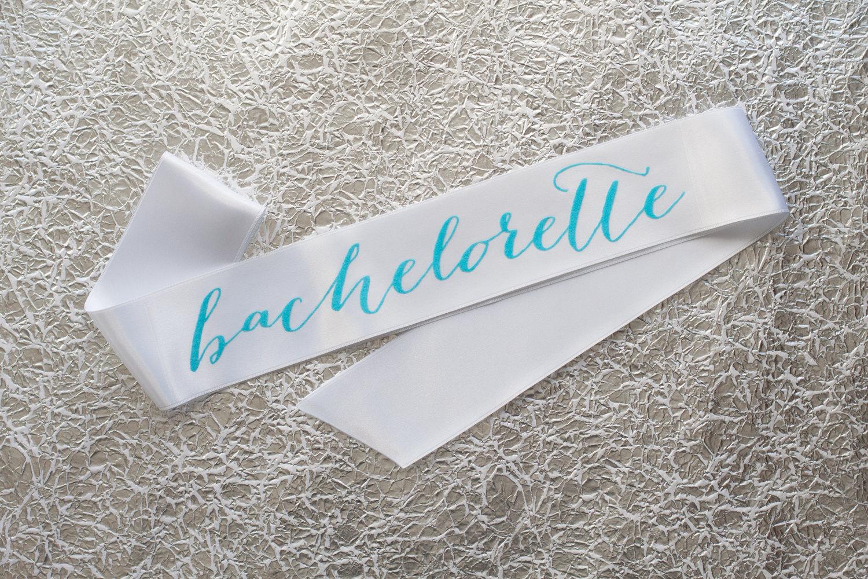 bachelorette sash with aqua writing | stylish bachelorette sash ideas | via https://emmalinebride.com/bride/bachelorette-sash-ideas/