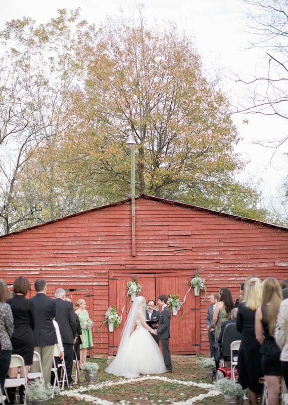 Rustic Fall Ceremony Ideas - red barn as ceremony backdrop with floral decor (photo by harwell photography)