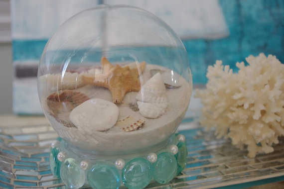 10 Beach Wedding Centerpieces via EmmalineBride.com - beach snow globe centerpiece idea by By The Seashore