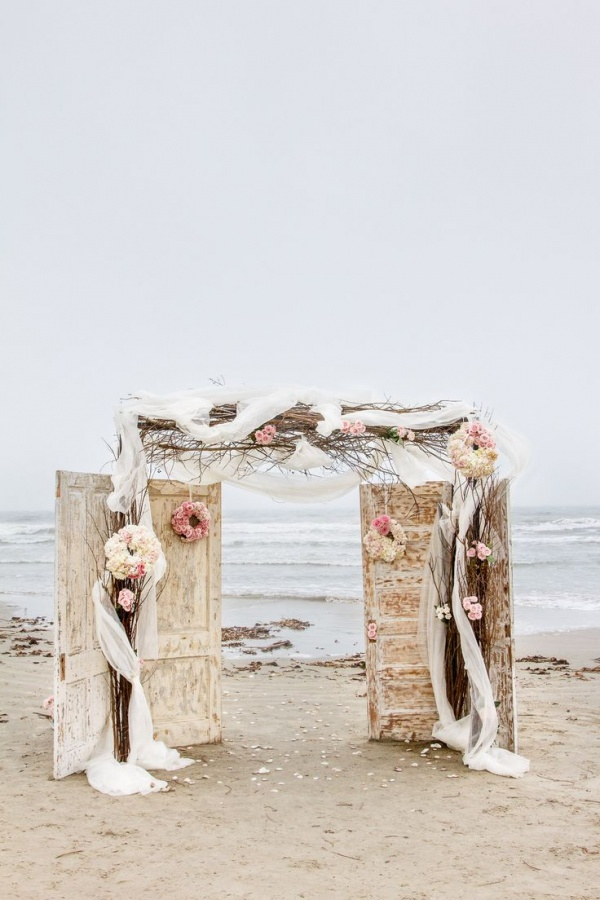 beach wedding ceremony backdrop with doors | Ceremony Backdrops Doors | photo: C Baron Photography