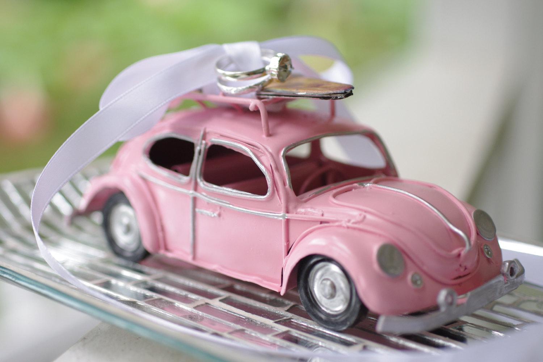 beach wedding surfboard on pink car ring pillow | via decorate for beach wedding ideas from emmalinebride.com