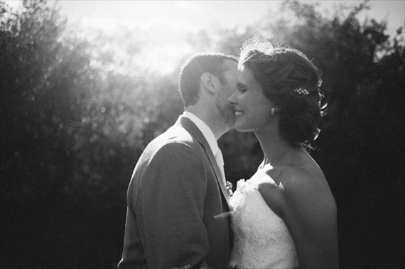 beautiful light groom kissing bride via 32 Secrets Wedding Photographers Wish You Knew