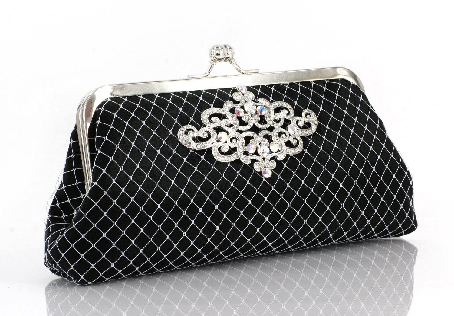 black and white clutch by angee w with rhinestone brooch
