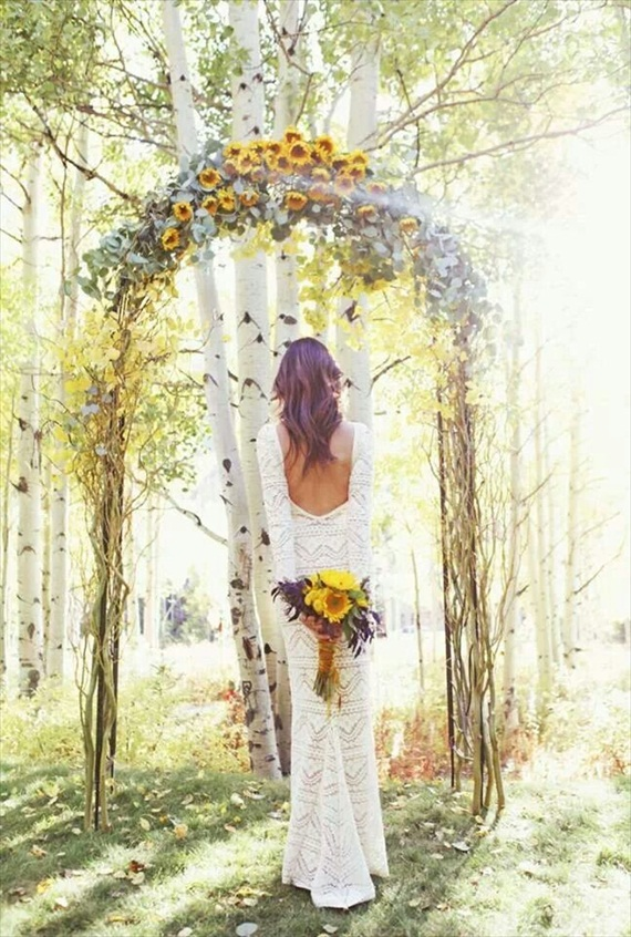 bohemian ceremony floral arch via 9 Bohemian Wedding Ideas for your Free Spirited Side