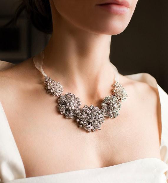 statement necklace | via Wedding Dress with Statement Necklace http://emmalinebride.com/bridal/wedding-dress-with-statement-necklace/