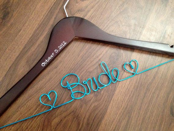 bride dress hanger | via 10 NEW Something Blue Ideas | https://emmalinebride.com/bride/new-something-blue/