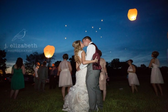 bride, groom, and wedding lanterns for a night wedding