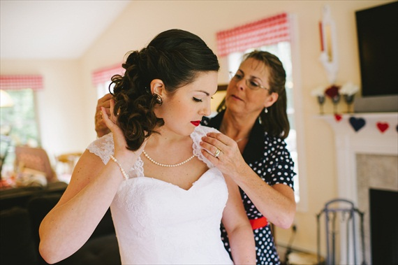 Americana Wedding: Libby + Ernie (photo: michelle gardella) - bride's pearl necklace being put on by her mother