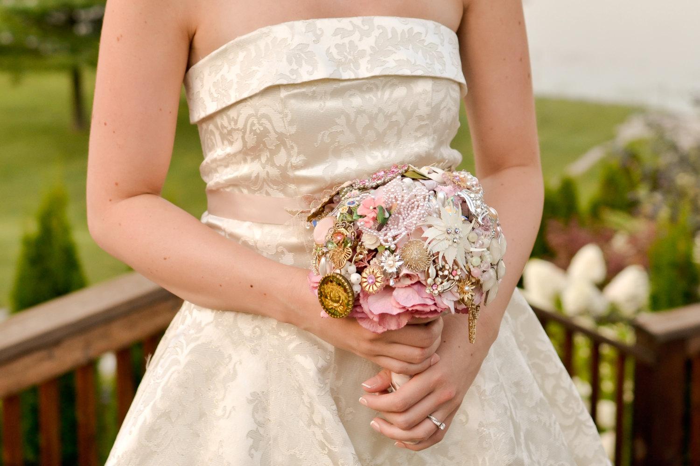 bride-holding-brooch-bouquet - Wedding Brooch Bouquet Ideas