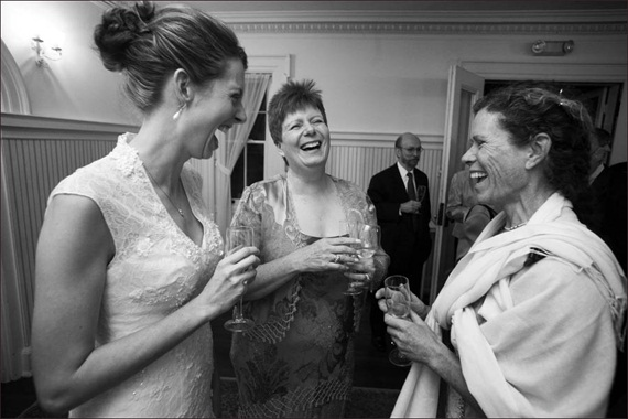 bride-laughs-with-guests - Liriodendron Mansion Wedding