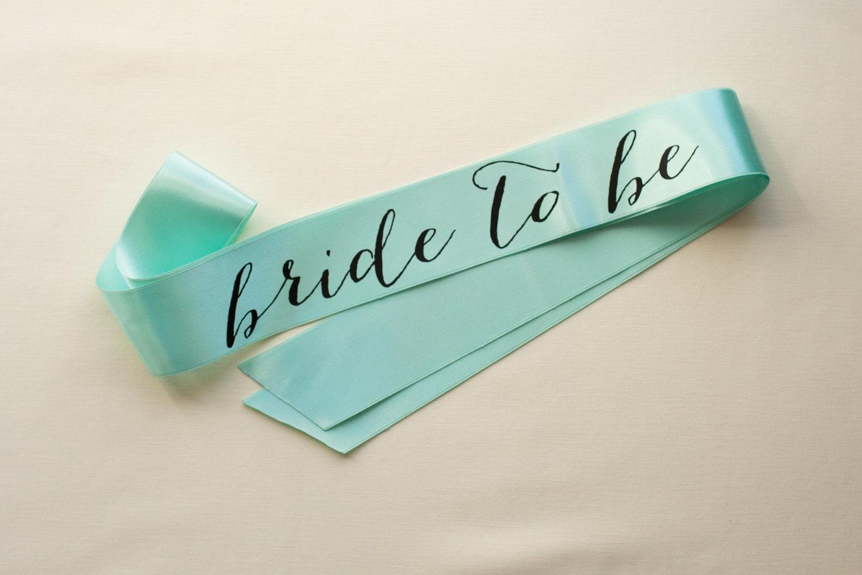 bride to be black on mint sash | stylish bachelorette sash ideas | via https://emmalinebride.com/bride/bachelorette-sash-ideas/