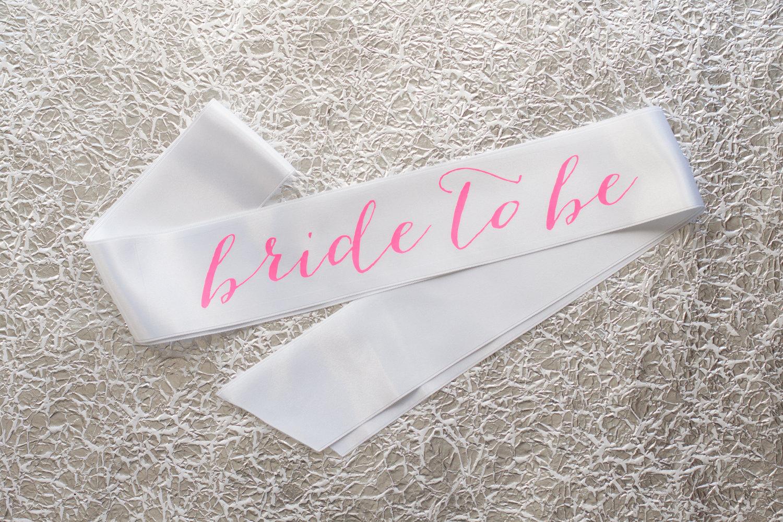 bride to be sash hot pink on white | stylish bachelorette sash ideas | via https://emmalinebride.com/bride/bachelorette-sash-ideas/