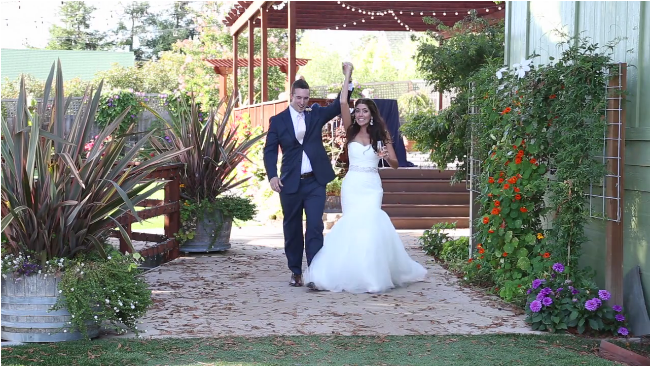 bride and groom wedding entrance in their Sova Gardens wedding film