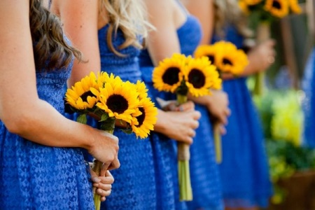 bridesmaids holding sunflower wedding bouquets