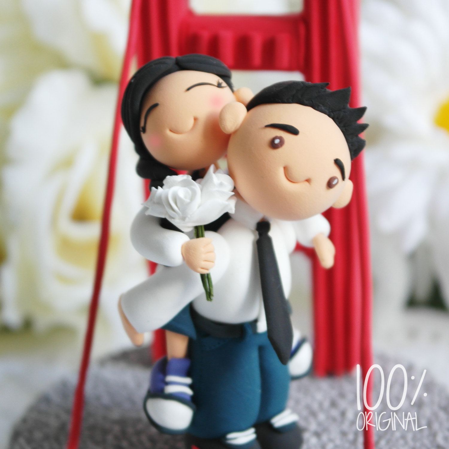 cake topper groom with bride on back golden gate bridge - 9 Adorable Custom Made Cake Toppers via https://emmalinebride.com/decor/custom-made-cake-toppers/