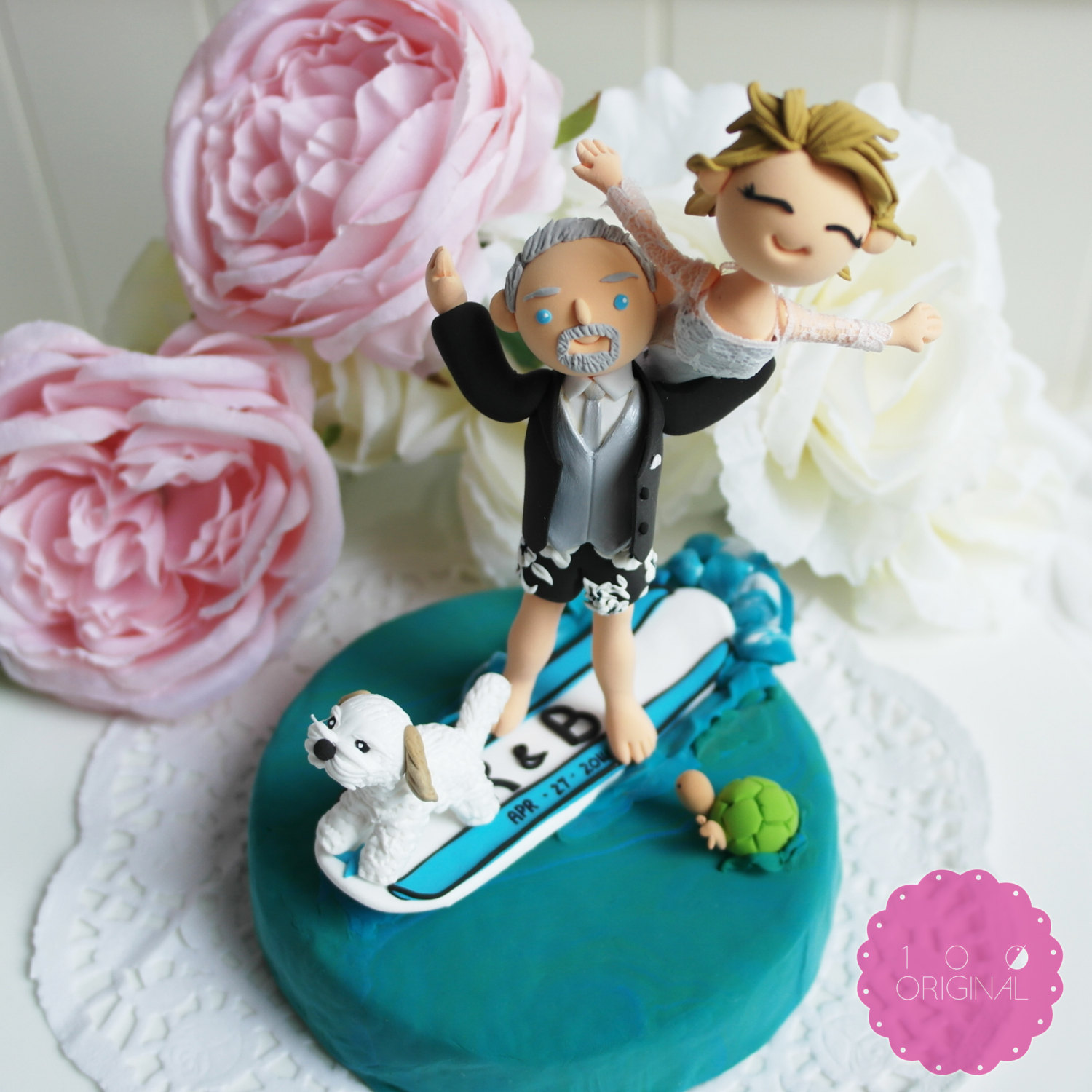 cake topper surfing bride and groom - 9 Adorable Custom Made Cake Toppers via https://emmalinebride.com/decor/custom-made-cake-toppers/