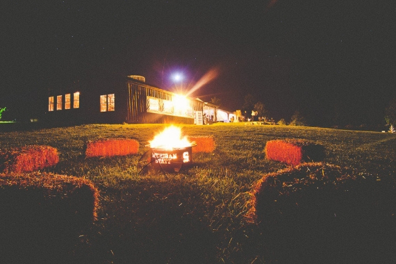 night wedding ideas: bonfire! hay bales make excellent outdoor seating