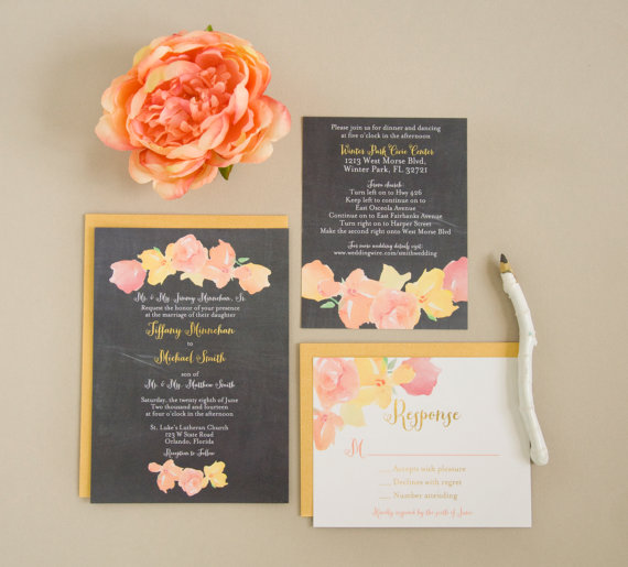 chalkboard wedding invitation with floral design via 8 Whimsical Wedding Invitations