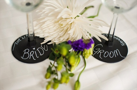 use chalkboard paint on wine stems as escort cards - 43 best wine themed wedding ideas