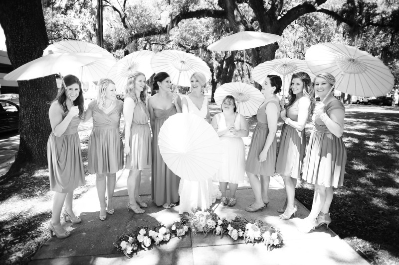 Bride and bridesmaids with parasols | Photographer: Melissa Prosser Photography | via https://emmalinebride.com/real-weddings/colleen-ryans-lovely-savannah-wedding-at-the-mansion-on-forsyth-park