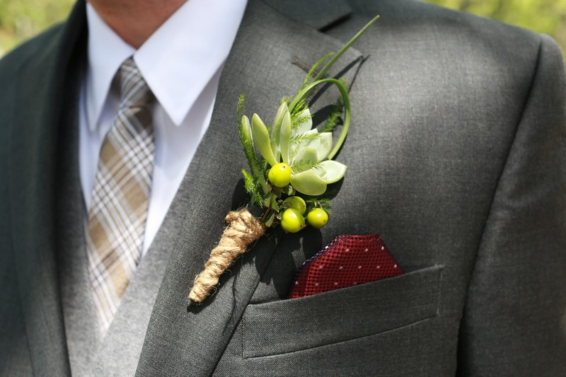 The groom's boutonniere included a succulent and was wrapped in jute twine. | Photographer: Melissa Prosser Photography | via http://emmalinebride.com/real-weddings/colleen-ryans-lovely-savannah-wedding-at-the-mansion-on-forsyth-park