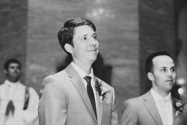 The groom watches as the bride walks down the aisle | Photo: Searching for the Light Photography LLC | via https://emmalinebride.com/real-weddings/colorado-chic-wedding-kendall-brian/