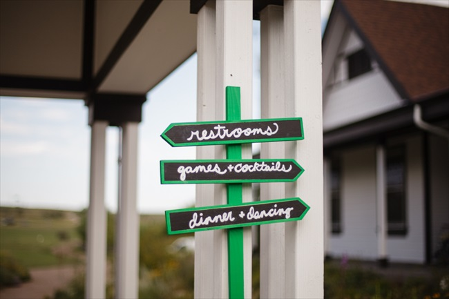 Signs leading the way for the wedding | Photo: Searching for the Light Photography LLC | via https://emmalinebride.com/real-weddings/colorado-chic-wedding-kendall-brian/