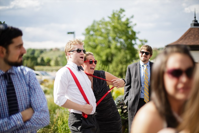 Couple, red suspenders | Photo: Searching for the Light Photography LLC | via https://emmalinebride.com/real-weddings/colorado-chic-wedding-kendall-brian/