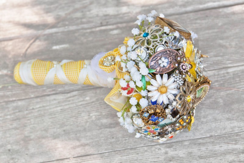 daisy brooch bouquet by hammer to lace | daisy ideas theme weddings