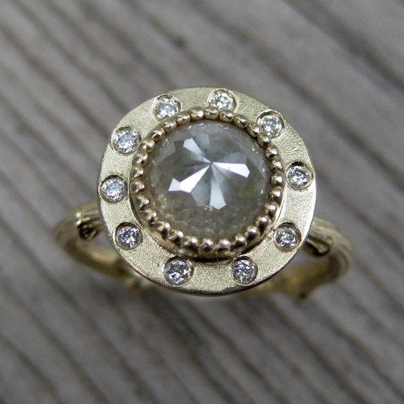 diamond halo twig engagement ring (via 7 Alternative Engagement Ring Ideas)